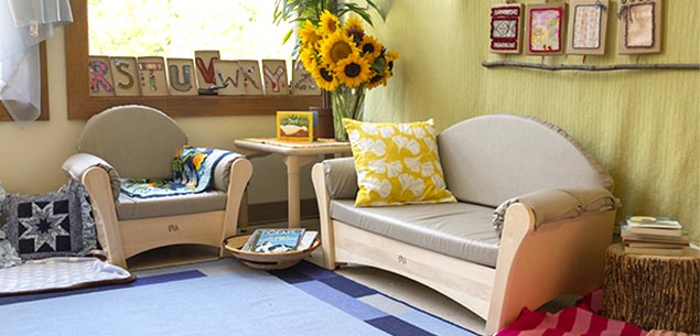 A cosy classroom corner furnished with sofas.